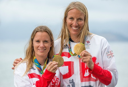 Hannah Mills and Saskia Clark with their Olympic Golds in Rio. picture: Richard Langdon